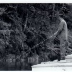 Fishing off dock in Hole in the Wall, 1964